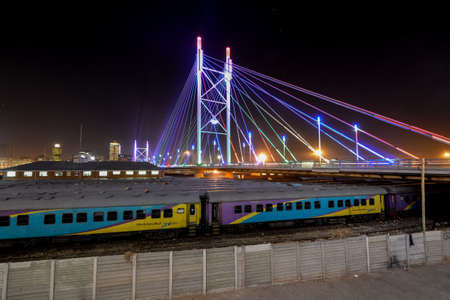 and south: Nelson Mandela Bridge at night. The 284 meter long Nelson Mandela Bridge, officially opened by Nelson Mandela himself, which crosses over the 40 railway lines that lie spread beneath its span.