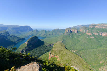 three sisters: Blyde River Canyon and The Three Rondavels (Three Sisters) in Mpumalanga, South Africa. The Blyde River Canyon is the third largest canyon worldwide
