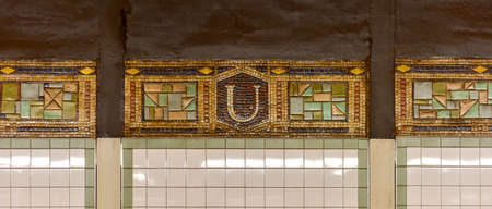 florescent light: New York, New York - July 12, 2015: Detailed tilework from the Union Square Subway Station in Manhattan.