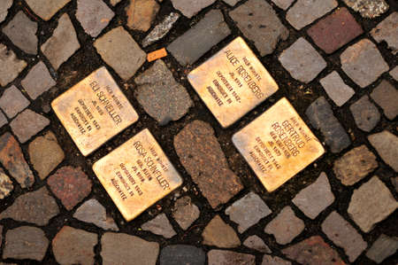 Berlin, Germany - November 4, 2010: Stolperstein (Stumbling Block) in Berlin. They are cobblestone-sized memorials on the pavements to commemorate a victim of Nazi oppression.