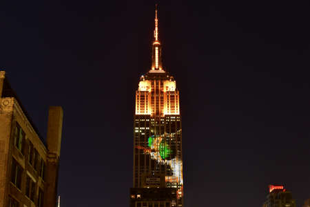 extinction: New York City - August 1, 2015: Endangered animals projected onto south side of the Empire State Building in New York City as part of the Racing Extinction project.