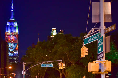 manhattan project: New York City - August 1, 2015: Endangered animals projected onto south side of the Empire State Building in New York City as part of the Racing Extinction project as seen from the Flatiron District.