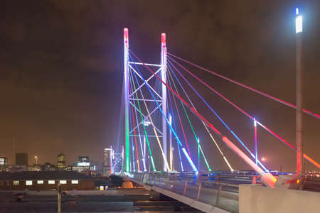 johannesburg: Nelson Mandela Bridge at night. The 284 metre long Nelson Mandela Bridge, starts at the end of Jan Smuts Avenue and linking Braamfontein to the Cultural precinct in Newtown. Stock Photo