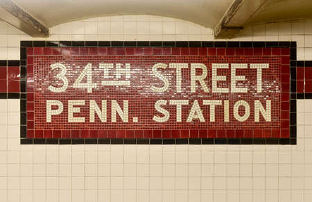 eighth: New York City - August 7, 2015: 34th Street Penn. Station New York City Subway sign in the 34th Street station of the Eighth Avenue NYC Subway line.