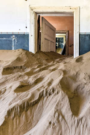 luderitz: The abandoned ghost diamond town of Kolmanskop in Namibia, which is slowly being swallowed by the desert. Stock Photo