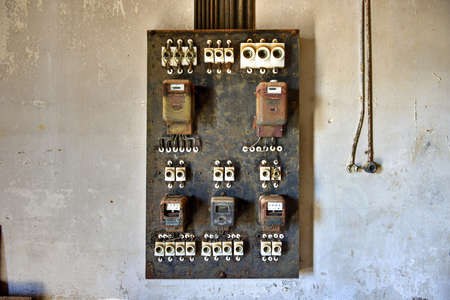 kolmannskuppe: Electrical panel in the abandoned ghost diamond town of Kolmanskop in Namibia, which is slowly being swallowed by the desert. Stock Photo