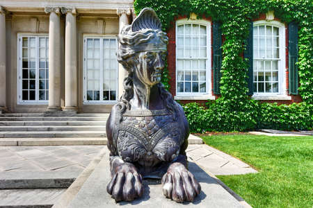 fitzgerald: Half woman-half lion statue in a Long Island Gold Coast Mansion at Old Westbury Gardens.