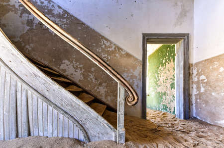 kolmanskop: The abandoned ghost diamond town of Kolmanskop in Namibia, which is slowly being swallowed by the desert. Stock Photo