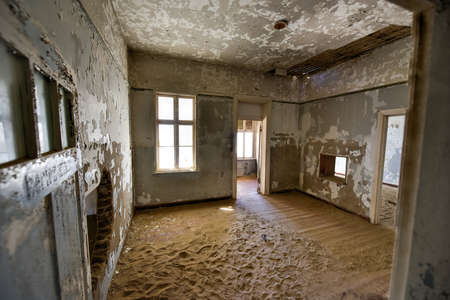 kolmannskuppe: The abandoned ghost diamond town of Kolmanskop in Namibia, which is slowly being swallowed by the desert. Stock Photo