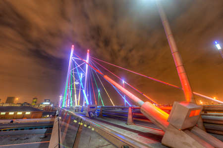 smuts: Nelson Mandela Bridge at night. The 284 metre long Nelson Mandela Bridge, starts at the end of Jan Smuts Avenue and linking Braamfontein to the Cultural precinct in Newtown. Editorial