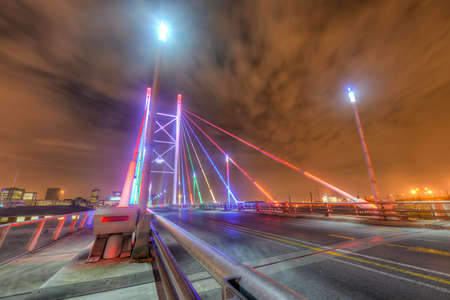 Nelson Mandela Bridge at night. The 284 metre long Nelson Mandela Bridge, starts at the end of Jan Smuts Avenue and linking Braamfontein to the Cultural precinct in Newtown. Editorial