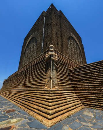 Monument to Piet Retief at Voortrekker Monument. The Voortrekker Monument is located just south of Pretoria in South Africa. This massive granite structure is prominently located on a hilltop, and was raised to commemorate the Voortrekkers who left the Ca