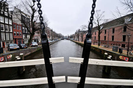 the netherlands: Amsterdam, Netherlands - February 24, 2012: Dutch canal of Amsterdam, Netherlands.