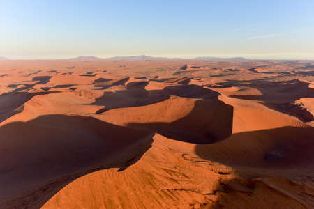 vlei: Aerial view of high red dunes, located in the Namib Desert, in the Namib-Naukluft National Park of Namibia.