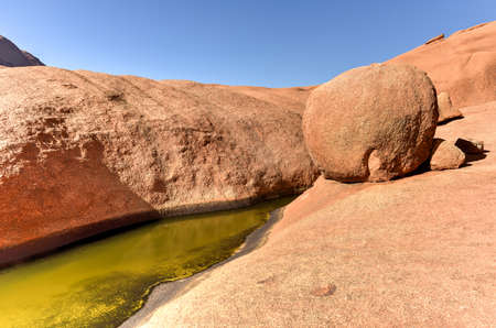 the water hole: Water hole in Spitzkoppe in the Namib desert of Namibia.