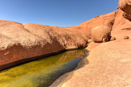 spitzkoppe: Water hole in Spitzkoppe in the Namib desert of Namibia.