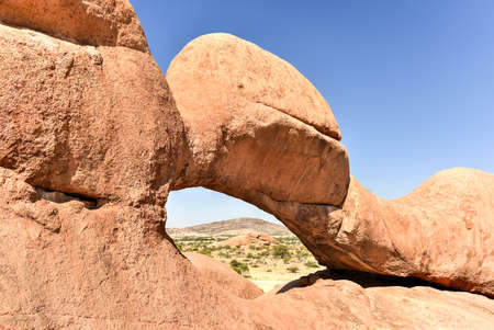 spitzkoppe: Landscape with massive granite arch in Spitzkoppe in the Namib desert of Namibia.