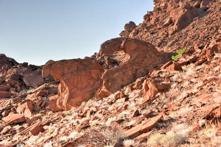 rock formation: The lions mouth rock formation throning on top of Huab valley in Twyfelfontein, Namibia.