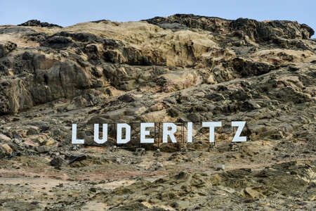 luderitz: Luderitz city sign in the cliffs of the town, in the coastal town in Namibia.