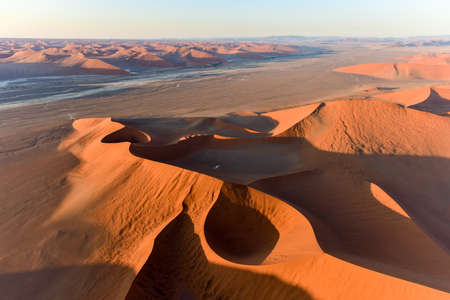 high desert: Aerial view of high red dunes, located in the Namib Desert, in the Namib-Naukluft National Park of Namibia.