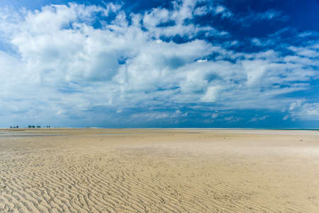 cloud drift: Magaruque Island, formerly Ilha Santa Isabel, is part of the Bazaruto Archipelago, off the coast of Mozambique.