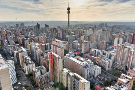 overpopulation: The Hillbrow Tower (JG Strijdom Tower) is a tall tower located in the suburb of Hillbrow in Johannesburg, South Africa. Stock Photo