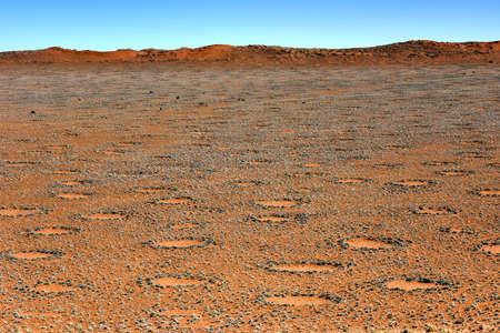 fairy: Fairy circles, located in the Namib Desert, in the Namib-Naukluft National Park of Namibia. Stock Photo