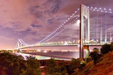 staten: Verrazano Bridge and Fort Wadsworth in Staten Island leading into Brooklyn, New York at night. Stock Photo