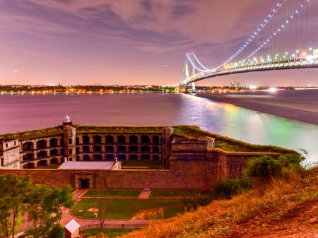 moon  metropolis: Verrazano Bridge and Fort Wadsworth in Staten Island leading into Brooklyn, New York at night. Stock Photo