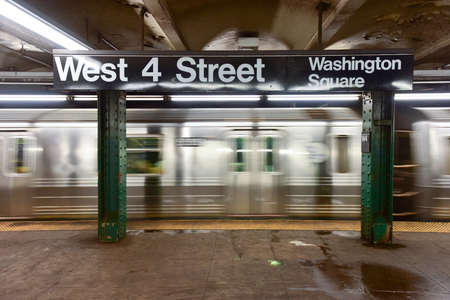 blur subway: New York City - October 7, 2015: The blur of a subway train passing through the West Fourth Street Subway stop in New York City.