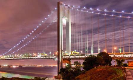 staten: Verrazano Bridge as seen from Staten Island leading into Brooklyn, New York at night.