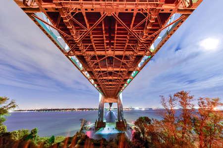staten: Verrazano Bridge underpass as seen from Staten Island leading into Brooklyn, New York at night.