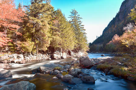 placid water: Adirondacks Peak Fall Foliage in upstate New York along the Ausable River.