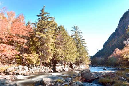 Adirondacks Peak Fall Foliage in upstate New York along the Ausable River.