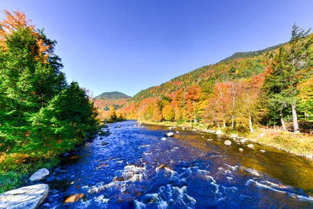 placid water: Adirondacks Peak Fall Foliage in upstate New York along the Ausable River and High Falls Gorge. Stock Photo
