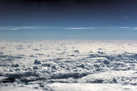 Clouds and sky from the thirty thousand feet in the air.