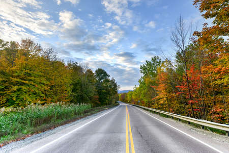 notch: Peak fall foliage along the road through Smugglers Notch, Vermont.