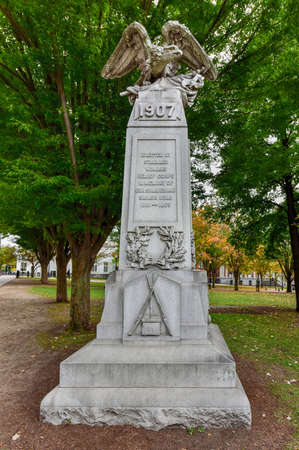 granite park: Civil War Memorial in City Hall Park in Burlington, Vermont. The granite monument is topped by a sculpture of a bald eagle. On each side is a relief sculpture for the army, navy, artillery and cavalry