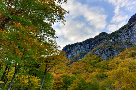 notch: Peak fall foliage in Smugglers Notch, Vermont.