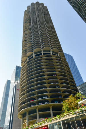 drawback: Chicago, Illinois - September 5, 2015: Marina City is a complex of two 60-story towers built in 1964  in Chicago, USA. Apartments, offices, restaurants, banks, theater,18 stories of parking space.