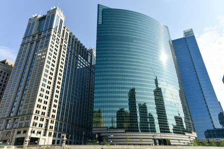 equitable: Chicago, Illinois - September 5, 2015: 333 West Wacker Drive is a highrise office building in Chicago, Illinois. On the Chicago River side, the building features a curved green glass facade. Editorial