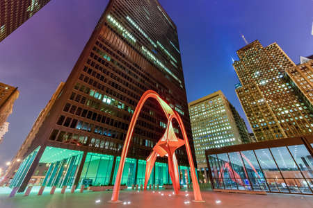 Chicago - September 6, 2015: Flamingo, in the Federal Plaza in Chicago at night. The stabile was constructed by American sculptor Alexander Calder, under the Percent for Art program.