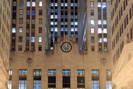 trading board: Chicago - September 6, 2015: Chicago Board of Trade Building at night in Chicago, Illinois. The art deco building was built in 1930 and first designated a Chicago Landmark on May 4, 1977. Editorial