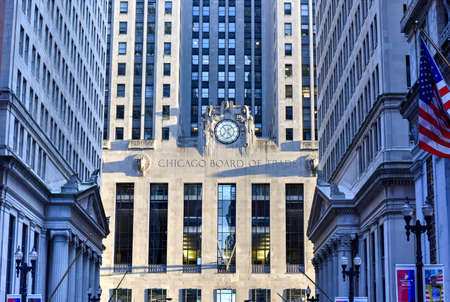 chicago city: Chicago - September 7, 2015: Chicago Board of Trade Building along La Salle street in Chicago, Illinois. The art deco building was built in 1930 and first designated a Chicago Landmark on May 4, 1977.