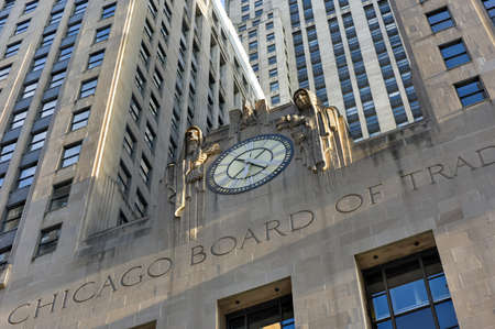 trading board: Chicago - September 7, 2015: Chicago Board of Trade Building along La Salle street in Chicago, Illinois. The art deco building was built in 1930 and first designated a Chicago Landmark on May 4, 1977.