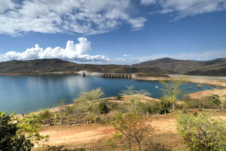 kilometres: The Maguga Dam is a dam on the Komati River in Hhohho, Swaziland. It is 115 metres high and is located 11 kilometres south of Piggs Peak.