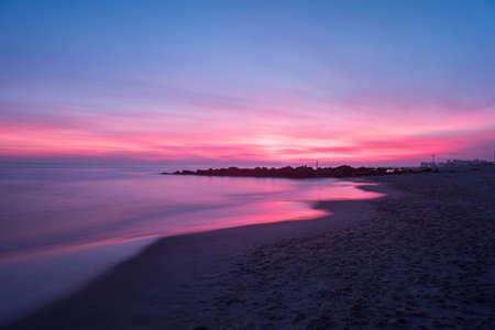 Dramatic sunset on Coney Island Beach in Brooklyn, New York.