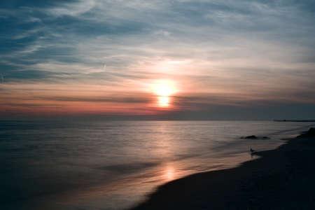 coney: Dramatic sunset on Coney Island Beach in Brooklyn, New York.
