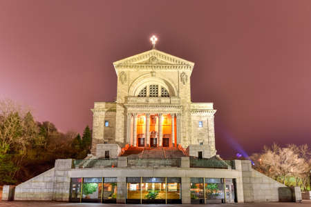 worshipper: Saint Josephs Oratory of Mount Royal, a Roman Catholic minor basilica and national shrine on Westmount Summit in Montreal, Quebec at night. It is Canadas largest church.