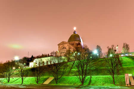 oratory: Saint Josephs Oratory of Mount Royal, a Roman Catholic minor basilica and national shrine on Westmount Summit in Montreal, Quebec at night. It is Canadas largest church.
